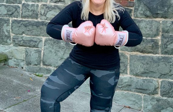 Jacqueline wearing Athleta Outfit and Everlast Boxing Gloves