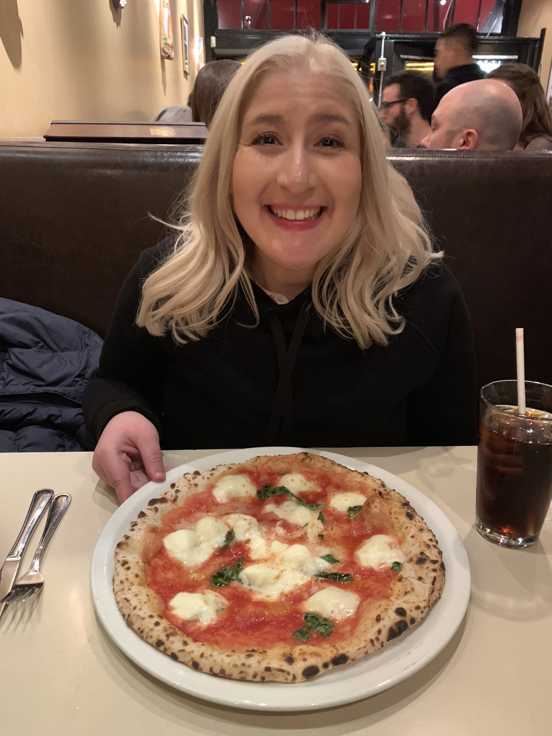 Jacqueline Eating a Margherita pizza from Tony's Napoletana in San Francisco